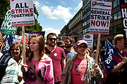 Demonstration in Central London on a day of General Strike action by public sector workers and unions. Civil servants, teachers, health workers all came out on a day of peaceful march and protest against government cuts which look set to see their pensions change.