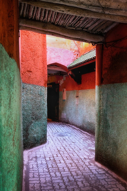 Typical alley in Marrakech, Morocco.  Soft light on colorful architecture.