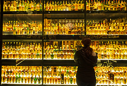 Many bottles of Scotch Whisky in Scotch Whisky Experience tourist visitor centre on Royal Mile in Edinburgh, Scotland, UK