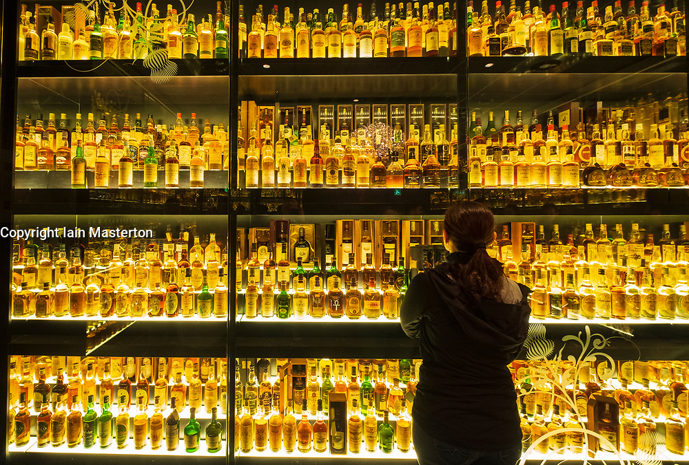 Many bottles of Scotch Whisky in Scotch Whisky Experience tourist visitor centre on Royal Mile in Edinburgh, Scotland, UK