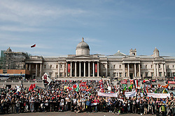 © licensed to London News Pictures. London, UK  01/05/11. Thousands of demonstrators stand beneath the National Gallery in Trafalgar Square as they wait to hear speeches as part of the annual Mayday demonstration in central London. Please see special instructions for usage rates. Photo credit should read Matt Cetti-Roberts/LNP