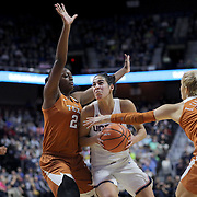 UNCASVILLE, CONNECTICUT- DECEMBER 4: Kia Nurse #11 of the Connecticut Huskies drives to the basket defended by Joyner Holmes #24 of the Texas Longhorns and Khaleann Caron-Goudreau #30 of the Texas Longhorns during the UConn Huskies Vs Texas Longhorns, NCAA Women's Basketball game in the Jimmy V Classic on December 4th, 2016 at the Mohegan Sun Arena, Uncasville, Connecticut. (Photo by Tim Clayton/Corbis via Getty Images)
