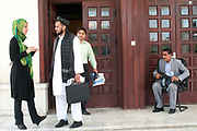 Naheed Farid, 27, from Herat. Afghanistan's youngest MP (Member of Parliament) with another MP and bodyguard. Kabul, Afghanistan.