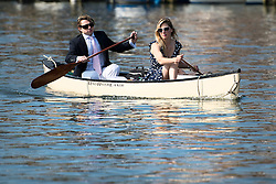 © London News Pictures. 05/07/2012.  Henley-on-Thames, UK. A couple enjoy a boat ride along the River Thames in the sunshine on Day three of Henley Royal Regatta on the River Thames at Henley-on-Thames, Oxfordshire on July 03, 2013. The 5 day regatta over the first weekend in July, races head-to-head knock out competitions over a course of 1 mile between rowing teams from throughout the world. Photo credit: Ben Cawthra/LNP