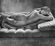 """Sleeping Hermaphroditus, The Borghese Hermaphrodite.  A Life size ancient 2nd century AD Roman statue sculpted in Greek Marble and found in the grounds of Santa Maria della Vittoria, near the Baths of Diocletian, Rome. It was added to the Borghese Collection by Cardinal Scipione Borghese, in the 17th century and was named the """"Borghese Hermaphroditus"""". It was later sold to the occupying French and was removed it to The Louvre. Hermaphrodite, son of Hermes and Aphrodite had repels the advances of the nymph Salmacis. However, she got Zeus as their two bodies are united in a bisexual being. The Sleeping Hermaphroditus has been described as a good early Imperial Roman copy of a bronze original by the later of the two Hellenistic sculptors named Polycles (150 BC) the original bronze was mentioned in Pliny's Natural History. In 1619  Bernini sculpted the mattress on which the ancient marble of Hermaphrodite lies. Louvre Museum, Paris.  Black and White Wall art print by Photographer Paul E Williams"""