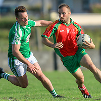 O'Curry's-Naomh Eoin's Niall Bonfil is challenged by Kilrush Shamrock's Ross Cullinan
