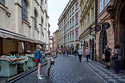 "Two women wearing face-masks are taking  pictures at the empty ""Karlova street"" which leads from Old-Town Square towards Charles Bridge and the Lesser Town (Mala Strana). The street belongs to the Royal Route which is normally one of the most frequented by tourist and now almost empty. The Czech government lowered the security measures and as of Monday 25 May 2020, wearing of protective masks will be mandatory only in the interiors of buildings other than the place of residence and in public transport."
