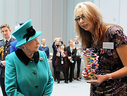 Queen Elizabeth II is shown a model of DNA by senior scientist Kathleen Mathers from the Francis Crick Institute, during her visit to officially open the institute in central London.