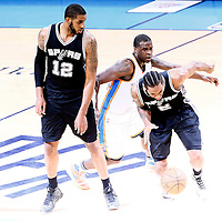 08 May 2016: San Antonio Spurs forward Kawhi Leonard (2) drives past Oklahoma City Thunder guard Dion Waiters (3) on a screen set by San Antonio Spurs forward LaMarcus Aldridge (12) during the Oklahoma City Thunder 111-97 victory over the San Antonio Spurs, during Game Four of the Western Conference Semifinals of the NBA Playoffs at the Chesapeake Energy Arena, Oklahoma City, Oklahoma, USA.
