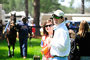 27 March 2010 : Fans pose for photos while horses parade for the first race in Camden SC.