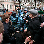 Members of Russia's OMON (Special Force) beat a crowd of peaceful protesters in Moscow. .Police detained Garry Kasparov, the former world chess champion who now leads one of Russia's strongest opposition movements, and at least 100 other activists as they gathered for a forbidden anti-Kremlin demonstration in central Moscow..The demonstration, one in a series of so-called Dissenters' Marches, increased tension between opposition supporters who complain the Kremlin is cracking down on political dissent and authorities who vow to block any unauthorized demonstrations.