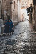 Jerusalem - October 20, 2010: Two nuns walk on Lion's Gate Street, on the Via Dolorosa, in the Old City of Jerusalem