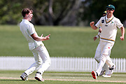 Blair Tickner of CD celebrates his dismissal of Canterbury captain Cole McConchie. Canterbury vs. Central Districts Day 2, 1st round of the 2021-2022 Plunket Shield cricket competition at Hagley Oval, Christchurch, on Sunday 24th October 2021.<br /> © Copyright Photo: Martin Hunter/ www.photosport.nz