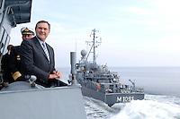 24 AUG 2006, OSTSEE/GERMANY:<br /> Franz Josef Jung, CDU, Bundesverteidigungsminister, auf dem Mienenjagdboot M 1065 DILLINGEN, FRANKENTHAL-Klasse (Typ 322), waehrend der Vorbeifahrt des Mienenjagtbootes KULMBACH, KULMBACH-Klasse (Typ 333) auf der Ostsee, im Rahmen seiner Sommerreise zu Standorten der Bundeswehr<br /> IMAGE: 20060824-01-049<br /> KEYWORDS: Marine, Bundeswehr, Schiff