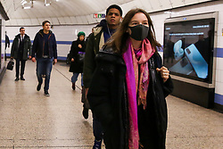 © Licensed to London News Pictures. 06/03/2020. London, UK. A non-Asian woman wearing a protective face mask at Green Park underground station. On Thursday 5 March a woman in her 70s with underlying health condition become the first person in the UK to die from coronavirus. 116 cases in the UK have tested positive of the virus. Photo credit: Dinendra Haria/LNP