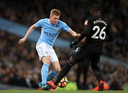 Manchester City's Kevin De Bruyne (left) and West Ham United's Arthur Masuaku battle for the ball