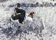 SHOT 1/25/08 12:32:38 PM - Snowboarder Travis Rice of Jackson Hole, Wyo. gets inverted over the money booter during practice Friday January 25, 2008 at Winter X Games Twelve in Aspen, Co. at Buttermilk Mountain. Rice didn't qualify for the finals in the event. The 12th annual winter action sports competition features athletes from across the globe competing for medals and prize money is skiing, snowboarding and snowmobile. Numerous events were broadcast live and seen in more than 120 countries. The event will remain in Aspen, Co. through 2010..(Photo by Marc Piscotty / © 2008)