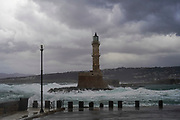 Lighthouse in stormy weather This is the Lighthouse in the old, Venetian harbour at Chania, Crete, Greece