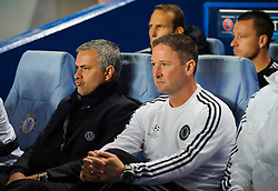 Chelsea Manager Jose Mourinho (POR) takes his seat in the dugout before the start of the match - Photo mandatory by-line: Rogan Thomson/JMP - Tel: 07966 386802 - 18/09/2013 - SPORT - FOOTBALL - Stamford Bridge, London - Chelsea v FC Basel - UEFA Champions League Group E