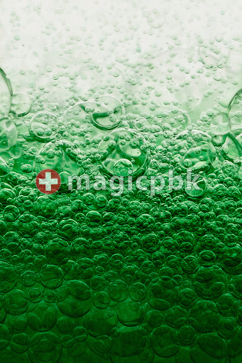 Bubbles seen in an Aura-Soma Equilibrium no. 13 (B13, Clear / Green) during a studio product photo session held at Aura-Soma Germany in Heiligenhaus, Germany, Saturday, Sept. 13, 2014. (Photo by Patrick B. Kraemer / MAGICPBK)