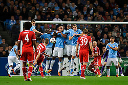 Bayern Midfielder Bastian Schweinsteiger (GER) strikes a free kick at the Man City wall during the first half of the match - Photo mandatory by-line: Rogan Thomson/JMP - Tel: Mobile: 07966 386802 - 02/10/2013 - SPORT - FOOTBALL - Etihad Stadium, Manchester - Manchester City v Bayern Munich - UEFA Champions League Group D.
