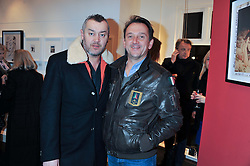 Left to right, SEBASTIEN BARBEREAU and ROB VAN HELDEN at a Private View of Bruno Bisang 30 Years of Polaroids held at The Little Black Gallery, 13A Park Walk, London SW10 on 15th January 2013.