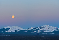 The High Park fire lookout tower at almost 9,500 feet was the perfect place to watch the April full moon rising. It was a location I scouted out in advance on Google Earth, when I was looking for an ideal foreground to the east. The two peaks are Hesse Mountain on the left and Hazelton Pyramid on the right. If you look closely to the upper right of the moon the planet Jupiter can be seen. Winter is far from over here in the high country. The 3 feet of snow made it a challenge to find a route to the summit since I had never climbed this peak before. But it was much easier on the way down since I could simply follow my snowshoe tracks and the bright moonlight meant I didn't even need a headlamp.