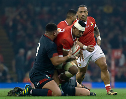 Fotu Lokotui of Tonga is tackled by Leon Brown of Wales<br /> <br /> Photographer Simon King/Replay Images<br /> <br /> Under Armour Series - Wales v Tonga - Saturday 17th November 2018 - Principality Stadium - Cardiff<br /> <br /> World Copyright © Replay Images . All rights reserved. info@replayimages.co.uk - http://replayimages.co.uk