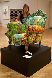 © Licensed to London News Pictures. 08/10/2012. LONDON, UK. A member of Bonhams staff examines a 'Poltroni di Proust' armchair designed by Alessandro Mendini in 1978 (est, GB£20,000-30,000) ahead of an auction at the auction house's New Bond Street premises. The auction, featuring a collection of contemporary art and design is set to take place on Thursday the 11th of October at Bonham's New Bond Street auction house. Photo credit: Matt Cetti-Roberts/LNP