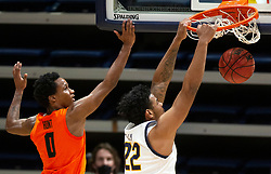Feb 25, 2021; Berkeley, California, USA; California Golden Bears forward Andre Kelly (22) dunks the ball ahead of Oregon State Beavers guard Gianni Hunt (0) during the second half of an NCAA college basketball game at Haas Pavilion. Mandatory Credit: D. Ross Cameron-USA TODAY Sports
