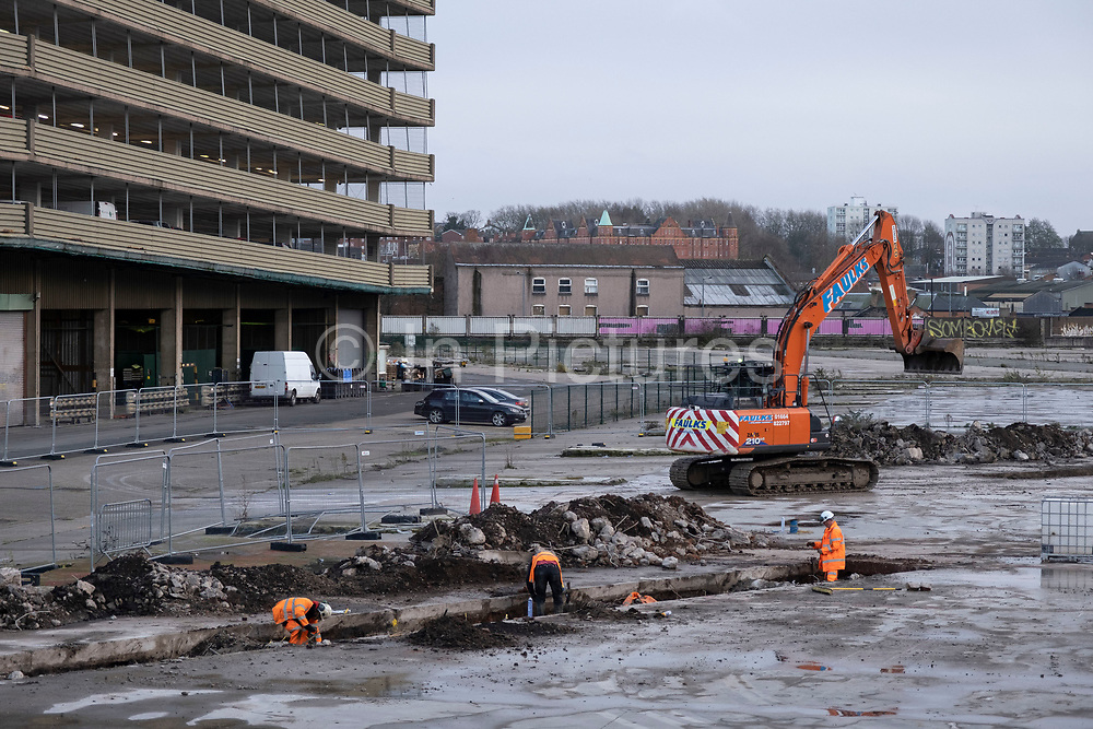 Workers seen undertaking unspecified preliminary construction work on the site of the empty area of the old Birmingham Wholesale Market Precinct, in the city centre on 14th December 2020 in Birmingham, United Kingdom. The site, which was once home to a bustling market has been desolate for years, but has now been ear-marked after it was announced that the Birmingham 2022 Commonwealth Games was going to use the site for events.