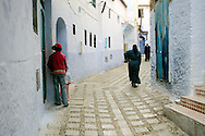 Morocco, Chefchaouen. People in the blue street.