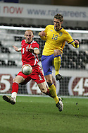 James Collins of Wales (l) challenges Sweden's Viktor Elm. International friendly, Wales v Sweden at the Liberty Stadium in Swansea on Wed 3rd March 2010. pic  by  Andrew Orchard