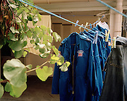 Drying blue overalls belonging to engineering ground staff of the Red Arrows, Britain's RAF aerobatic team.