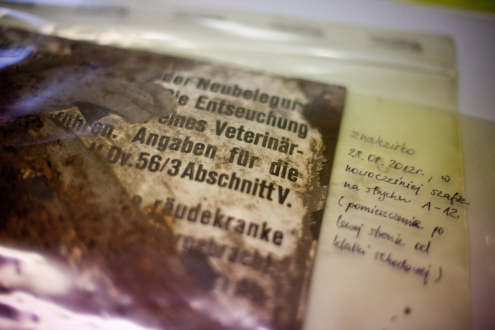 An original sign prepared for preservation at the Auschwitz Museum Preservation lab. The Department uses the most advanced technical methods possible within the financial resources of the Museum. The emphasis falls on the greatest feasible preservation of extant original material, introducing the bare minimum of additional, clearly marked elements in order to rescue and interpret the original items while making them accessible to visitors. The Museum Preservation Department is responsible for protecting everything that remains at the Auschwitz-Birkenau Concentration Camp site.