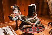 Frog hat (Xixch'i s'aaxw) from Sitka, Kiks.adi Clan, Sheet'ka Kwaan, Tlingit, displayed in Alaska State Museum, Juneau, USA. The City and Borough of Juneau is the capital city of Alaska and the second largest city in the USA by area (only Sitka is larger). This unified municipality lies on Gastineau Channel in the Alaskan panhandle. Juneau has been the capital of Alaska since 1906, when the government of what was the District of Alaska was moved from Sitka. The city is named after a gold prospector from Quebec, Joe Juneau. Isolated by rugged terrain on Alaska's mainland, Juneau can only be reached by plane or boat. Downtown Juneau sits at sea level under steep mountains up to 4000 feet high, topped by Juneau Icefield and 30 glaciers.