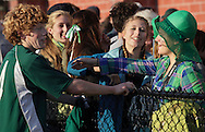 Middletown, New York - A girl reaches to hug a Hamilton High School soccer player after Hamilton defeated Chazy in the New York State Class D boys' soccer championship game on Nov. 20, 2011.