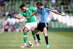 Republic of Ireland's Cyrus Christie and Uruguay's Diego Laxalt battle for the ball during the international friendly at The Aviva Stadium, Dublin.