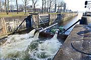 Nederland, The Netherlands, Heumen, 6-1-2017Rijkswaterstaat heeft een derde pom, naast de twee waterpompen, laten aanrukken om vanuit de Maas water te pompen in het Maas-waalkanaal. Hierdoor kan het stuk tot aan de rivier de Waal, waaronder een industriegebied bij Nijmegen, weer bevaren worden. De pompon hebben een capaciteit van 1400 liter per seconde.Foto: Flip FranssenVertaling EngelsHeumen, The Netherlands, 6-1-2017Rijkswaterstaat has two water pumps to pump water from the Maas to the Maas-waal channel. This allows ships to use the stretch up to the Waal River, including an industrial area near Nijmegen, to navigate again. The pumps have a capacity of 1400 litres per second. Photo: Flip Franssen