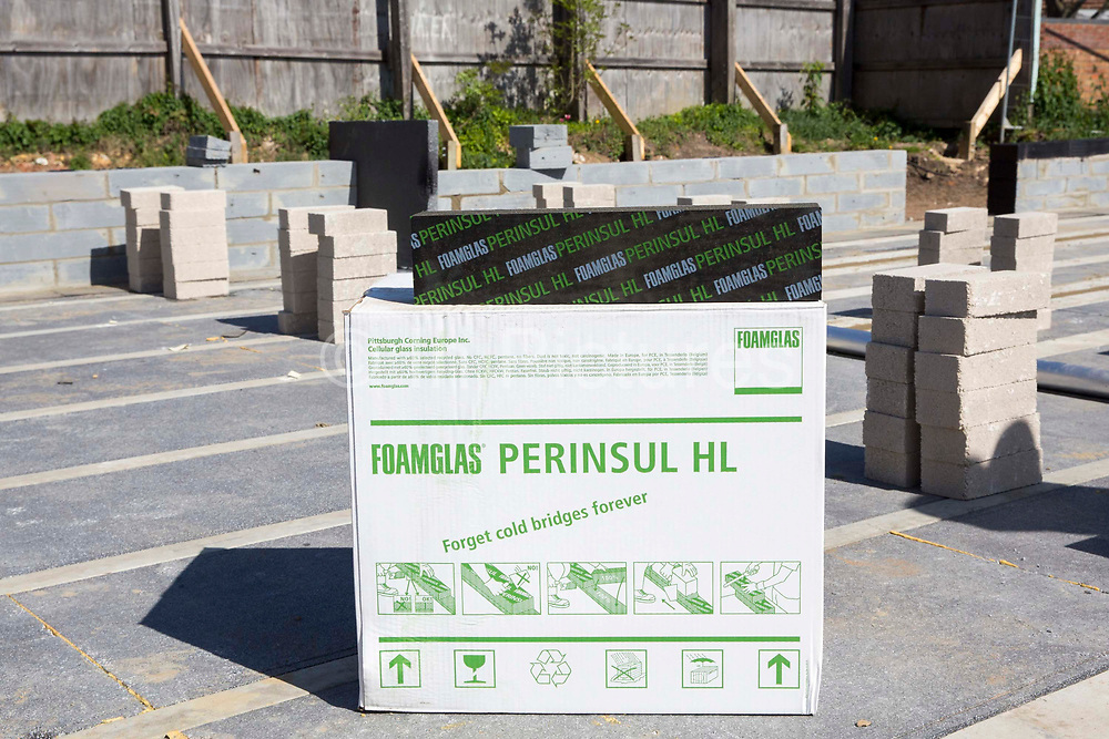 A box of Foamglas Perinsul HL used for thermal insulation in the foundations of a new house on a home building construction site in Norwich. Norfolk. United Kingdom.