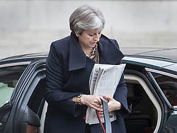 © Licensed to London News Pictures. 29/01/2018. London, UK. Prime Minister Theresa May carries a pile of newspapers as she arrives in Downing Street ahead of a Brexit Committee meeting.  Photo credit: Peter Macdiarmid/LNP