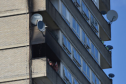 © Licensed to London News Pictures. 23/08/2019. London, UK.  General view of Markland House. A fire broke out on the 12th floor of a tower block very close to the devastating inferno that destroyed Grenfell Tower killing 72 people two years ago. Ten engines and 70 firefighters brought the blaze under control which gutted the apartment and spread externally along satellite cables. Residents of Markland House self evacuated and commented that no fire alarms were heard in the building.  Photo credit: Guilhem Baker/LNP