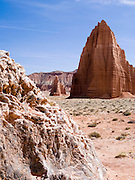 Close-up image of selenite crystals (gypsum, calcium sulfate) at Glass Mountain, with the Temples of the Sun (near) and Moon (far) in the background, Hartnett Draw, Capitol Reef National Park, Utah.