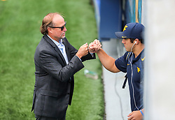 Sep 8, 2018; Morgantown, WV, USA; West Virginia Mountaineers head coach Dana Holgorsen greets West Virginia Mountaineers linebacker Dylan Tonkery (10) as they arrive to the field prior to their game against the Youngstown State Penguins at Mountaineer Field at Milan Puskar Stadium. Mandatory Credit: Ben Queen-USA TODAY Sports