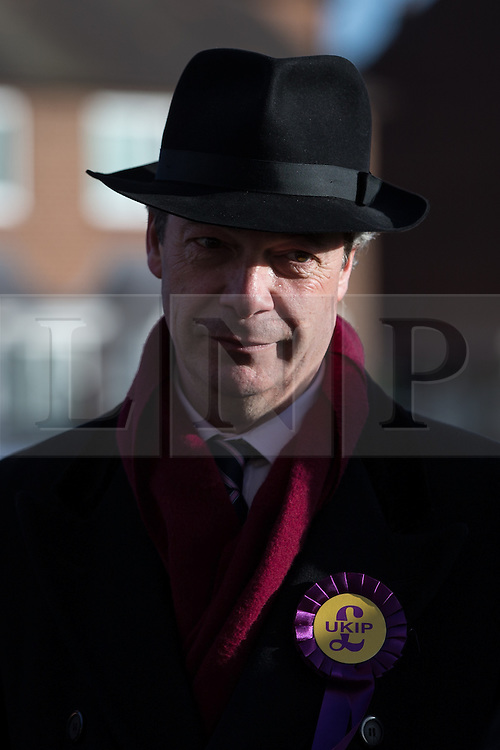 © Licensed to London News Pictures . 01/02/2014 . Manchester , UK . NIGEL FARAGE , the leader of the UK Independence Party ( UKIP ) joins candidate John Bickley on the campaign trail ahead of the Wythenshawe and Sale East by-election , following the death of MP Paul Goggins . Photo credit : Joel Goodman/LNP