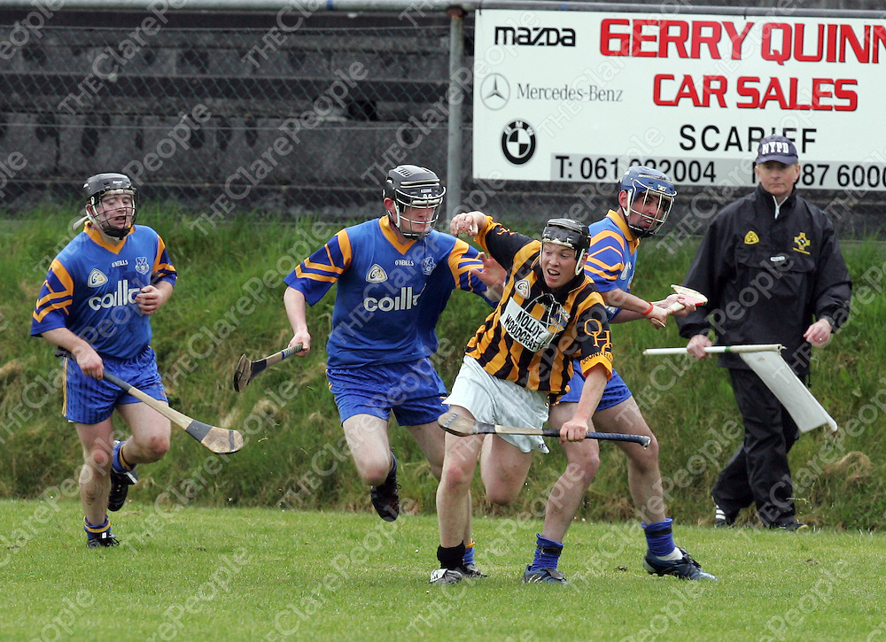 Killanena's Mark Flaherty tracks Henry Vaughan of Ogonelloe in the Clare Under 21C Final in Scariff on Saturday.<br />Picture: Don Moloney / Press 22