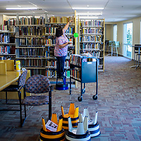 Zollinger Library employee Yolonda Chavez begins an inventory of books that were relocated to the expansion of the Zollinger Library at the University of New Mexico Gallup Monday. The library expansion is scheduled to open August 1.