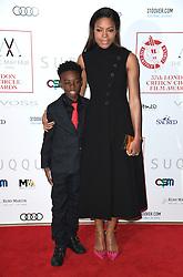 Alex Hibbert and Naomie Harris arriving at the London Film Critics Circle Awards 2017, the May Fair Hotel, London.