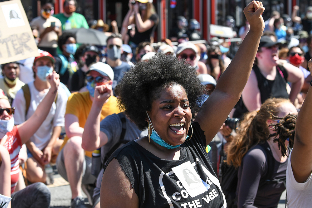 A protester holds up her fist in defiance during the March and Vigil for George Floyd on June 6, 2020 in Nashville, TN