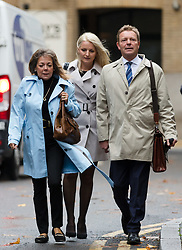 © Licensed to London News Pictures. 15/10/2018. London, UK.  CRAIG MACKINLAY (R) with his wife, Kati (C) arrives at Southwark Crown Court in London for a trial in connection with charges of illegal election spending during the 2015 general election. South Thanet MP Craig Mackinlay, 51, campaign director Marion Little, 63, and election agent Nathan Gray, 29, have each been charged with offences under the Representation of the People Act 1983.  Photo credit: Vickie Flores/LNP